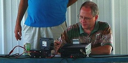 Jim Graver, Owner of Web-Rx Consulting,  operating an amateur radio during Field Day.